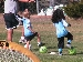 U6 boy and girl foot on ball