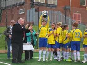 Shauna Hols The Cup Up High