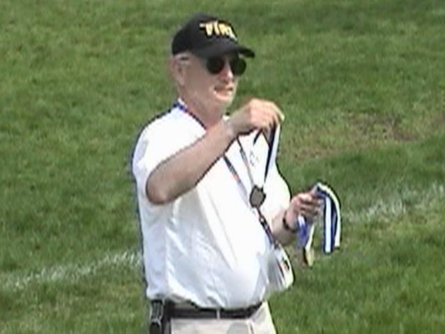 Coach Ken Reis Hands Out Awards
