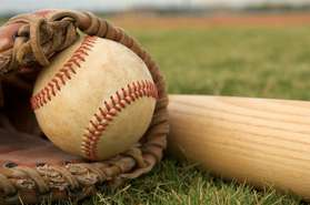 baseball in glove on field