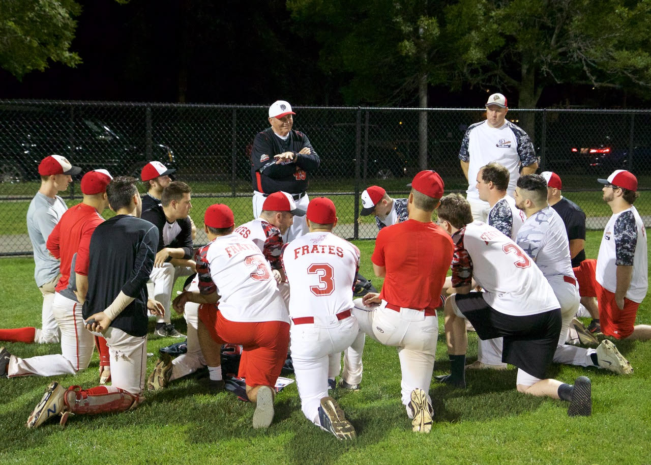 Coach Halsey Talks to Team After Game
