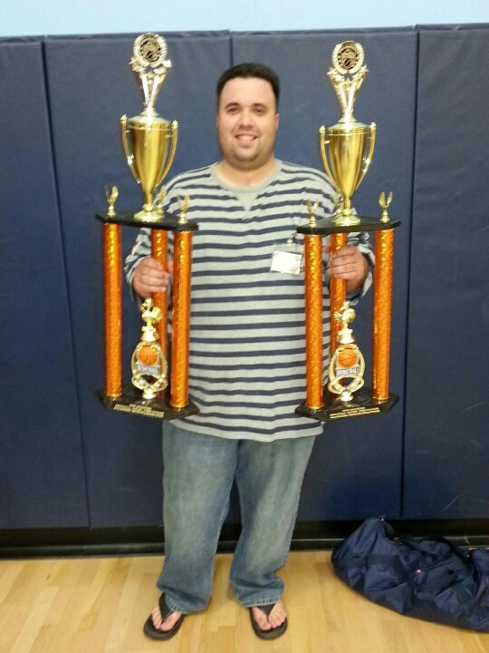 Coach Henry posing with both trophies